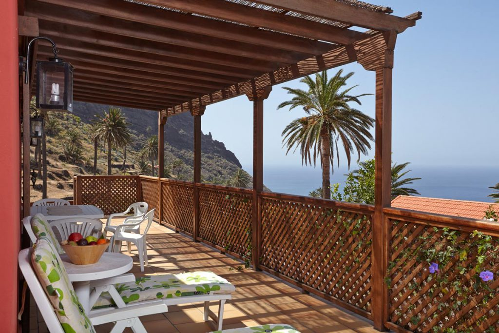 terrace with view of the sea and palms